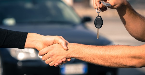 Transfer of keys to a car that was bought at an auction