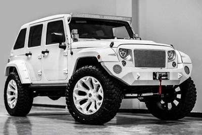 a white 2017 jeep wrangler sport