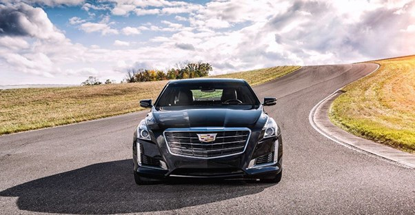 Cadillac driving on an open road. Best Cadillac models of 2017.
