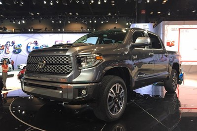 a 2018 toyota tundra in a showroom