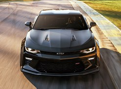 a black 2018 chevrolet camaro driving down the road