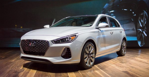a white 2018 hyundai elantra in a showroom