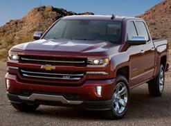 a red 2018 chevy silverado 1500 offroading