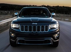a black 2018 jeep grand cherokee driving toward the viewer