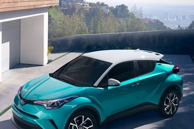 a teal and white 2018 toyota chr in a driveway