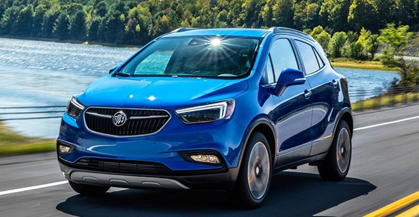 a blue 2018 buick encore driving down the road