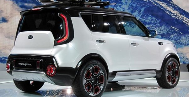 a white and black two toned 2018 kia soul in a showroom