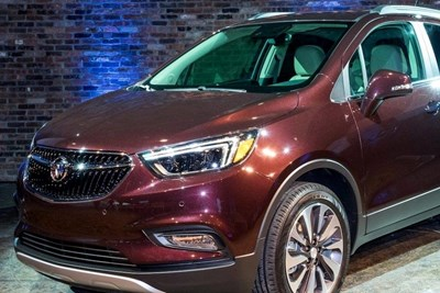 a maroon 2019 buick encore in a showroom