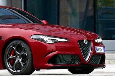 a red 2018 alfa romeo giulia front grill and headlights