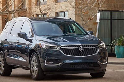 a 2019 buick enclave driving down the street
