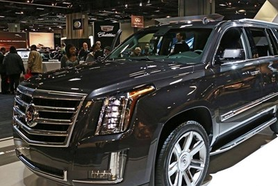 a dark gray 2019 cadillac escalade at an auto show