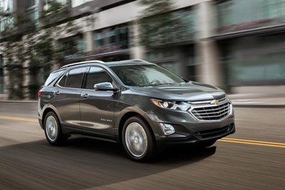 a grey 2019 chevrolet equinox driving down the road