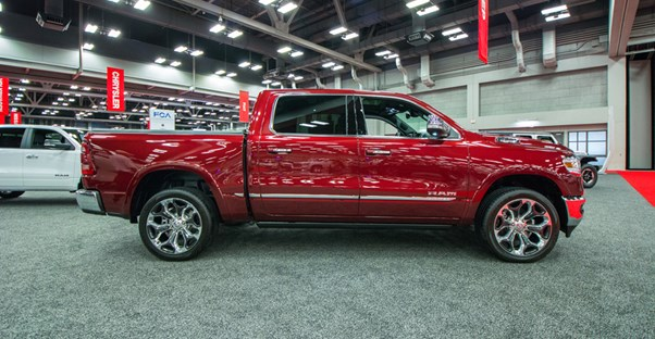 a red 2019 ram 1500 at an auto show