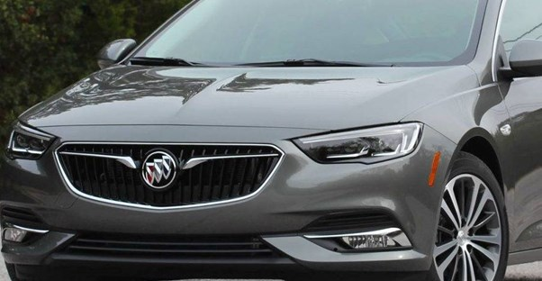 a close up view of the 2019 buick regal grille while it sits in a driveway