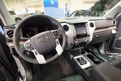 the steering wheel and dash interior of a 2019 toyota tundra