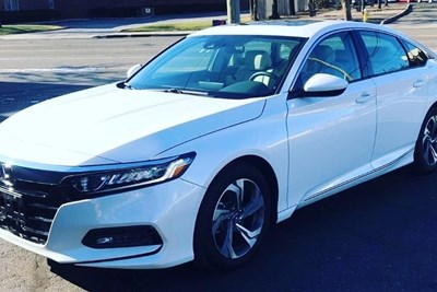 a white 2019 honda accord parked in a parking lot