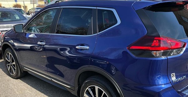 a 2019 blue nissan rogue in a parking lot
