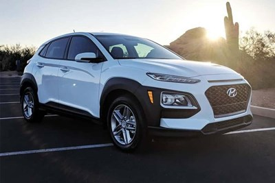 a white 2019 hyundai kona parked in a parking lot