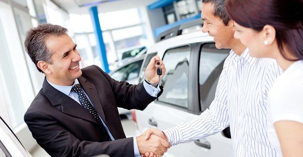 a customer haggling with a salesperson over a new car