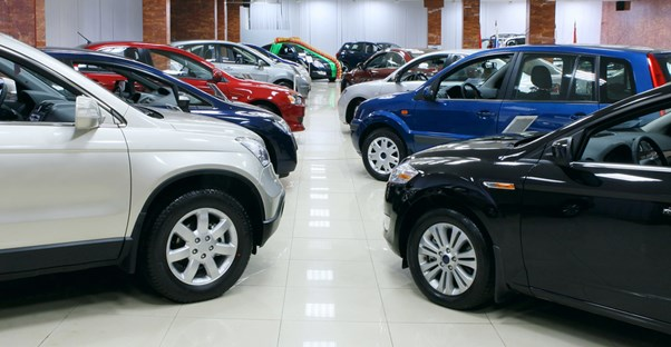 a showroom filled with new cars