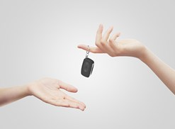 handing car keys to outstretched hand