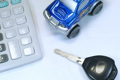 tiny car with car keys and calculator