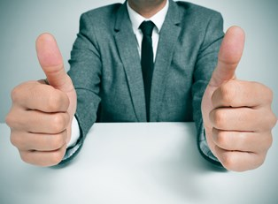 Man gives thumbs up for his successful title loan