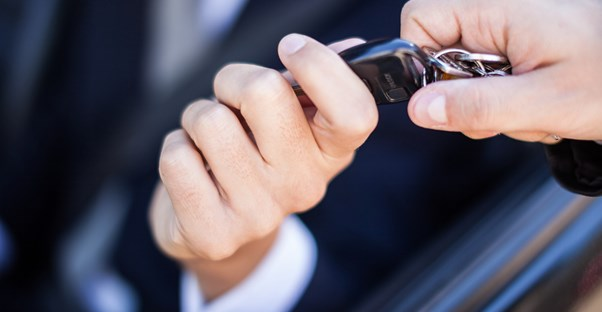 Man handing over the keys to a newly leased car