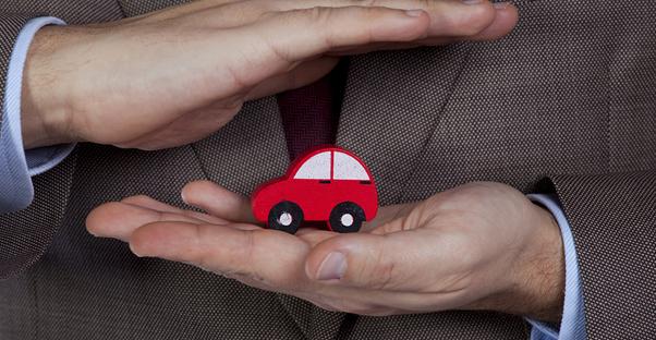 Man holding an insured car