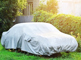 A weather resistant car cover on a car