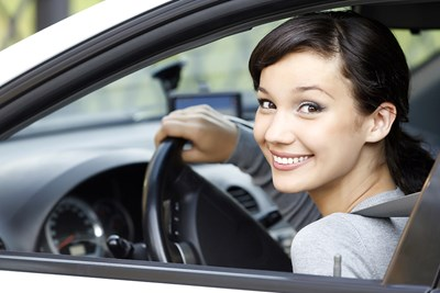 girl smiling in car after trading in